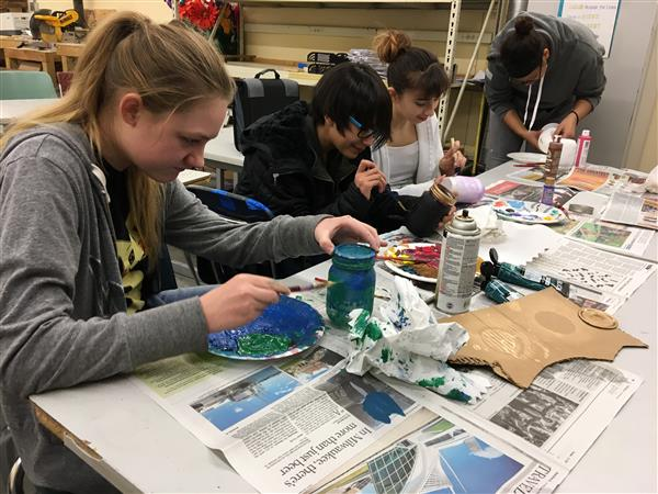 Art Club students working on painting a variety of projects